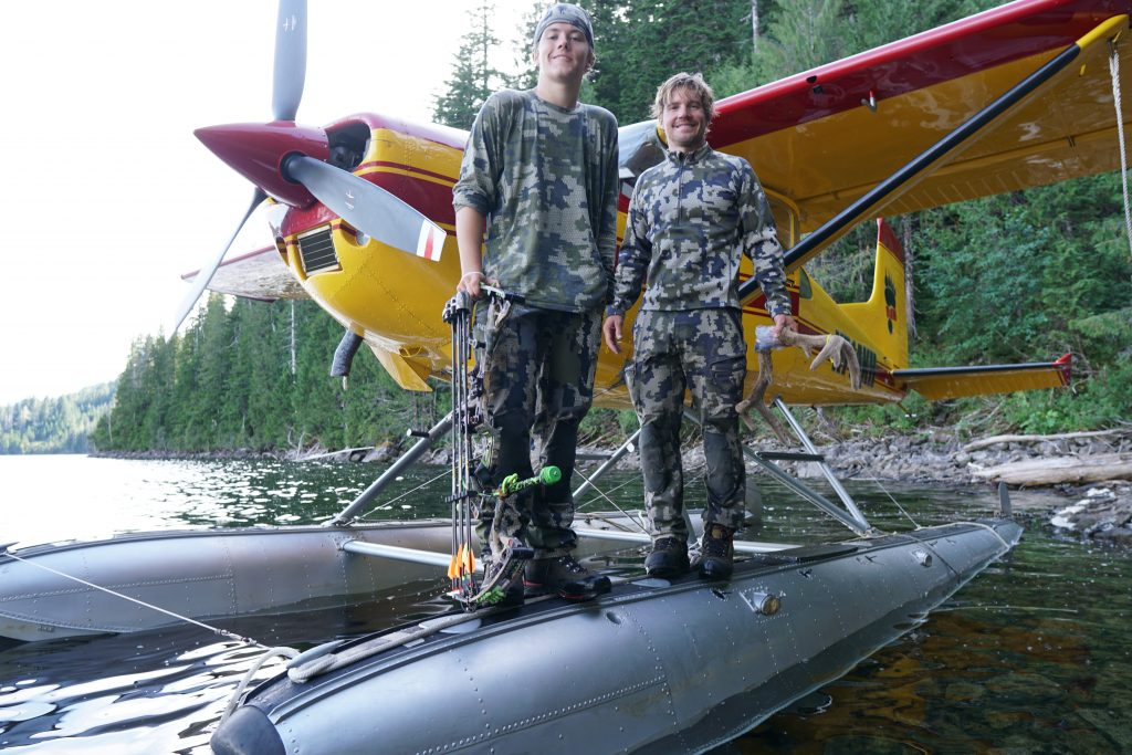 Allen and his son on a float plane.