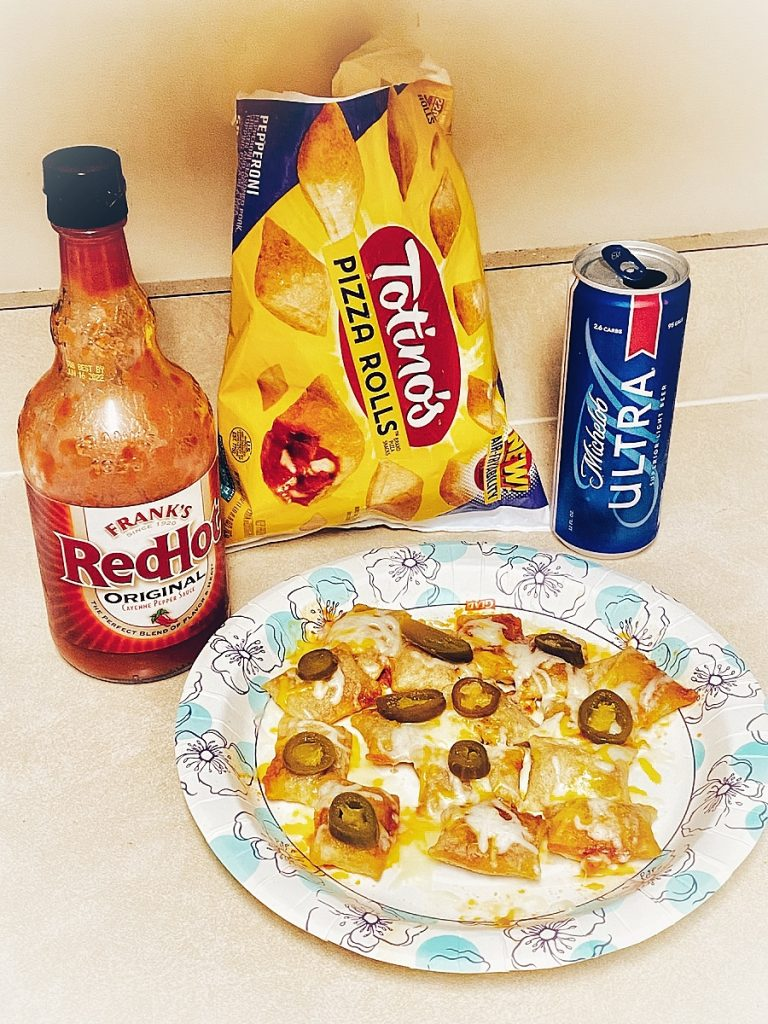 Pizza rolls with Frank's Red Hot and a light beer.